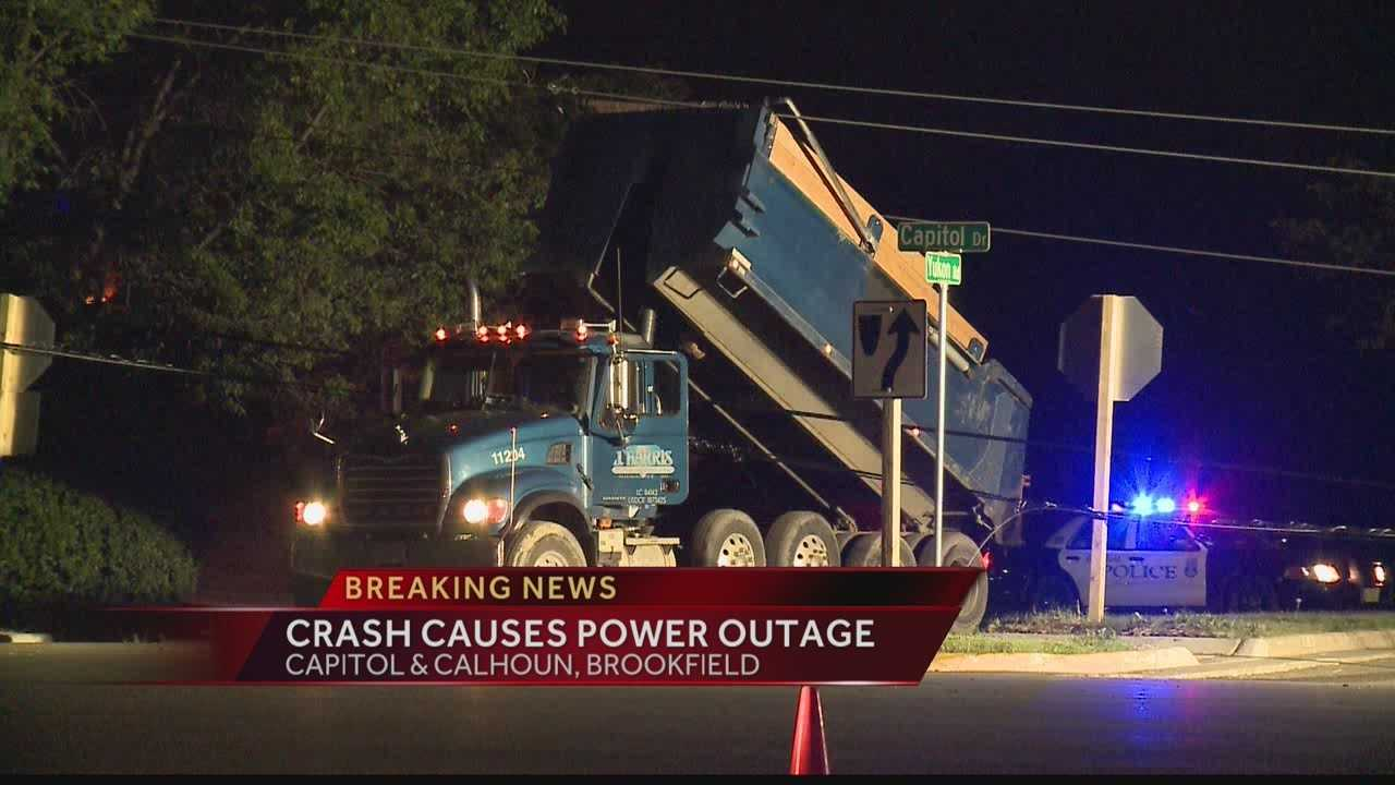 Police say a dump truck hit power lines in Brookfield, knocking out power to hundreds of homes.