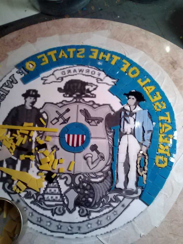 The State Seal will be centered on the back. It's being laid out backwards & will be applied later.