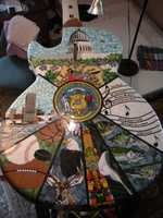Capitol dome applied, along with state bird and flower. Grout will soon follow.