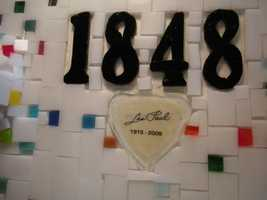 Wisconsin's birthdate, combined with a pick with Les Paul's birth and death, grace the top of the neck.