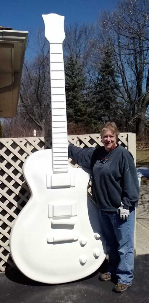 Pat Mitchell of Menomonee Falls spent nearly two months creating a Wisconsin-themed guitar for Guitar Town. It all started with a 10-foot fiberglass guitar.