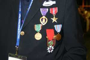 The vets are encouraged to wear any of their old uniform, metals, hats and insignias.