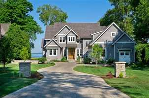 This home has five bedrooms and six baths and blends old world charm and modern conveniences.  Built in 2012, you'll find this house on the shores of Lake Mendota.  For more information about this property, click here.