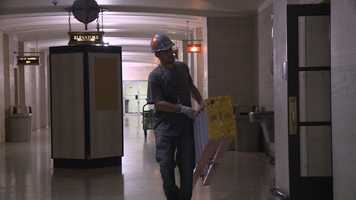 Cleaning and restoration crews are working throughout the building to clean up residue and damage from a weekend fire in the basement of the courthouse.