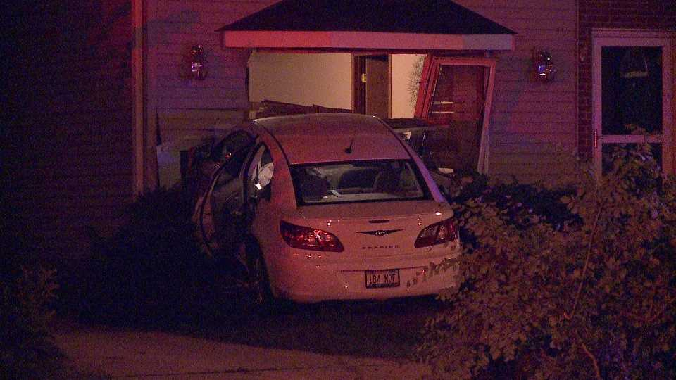 Car crashes into house in Milwaukee