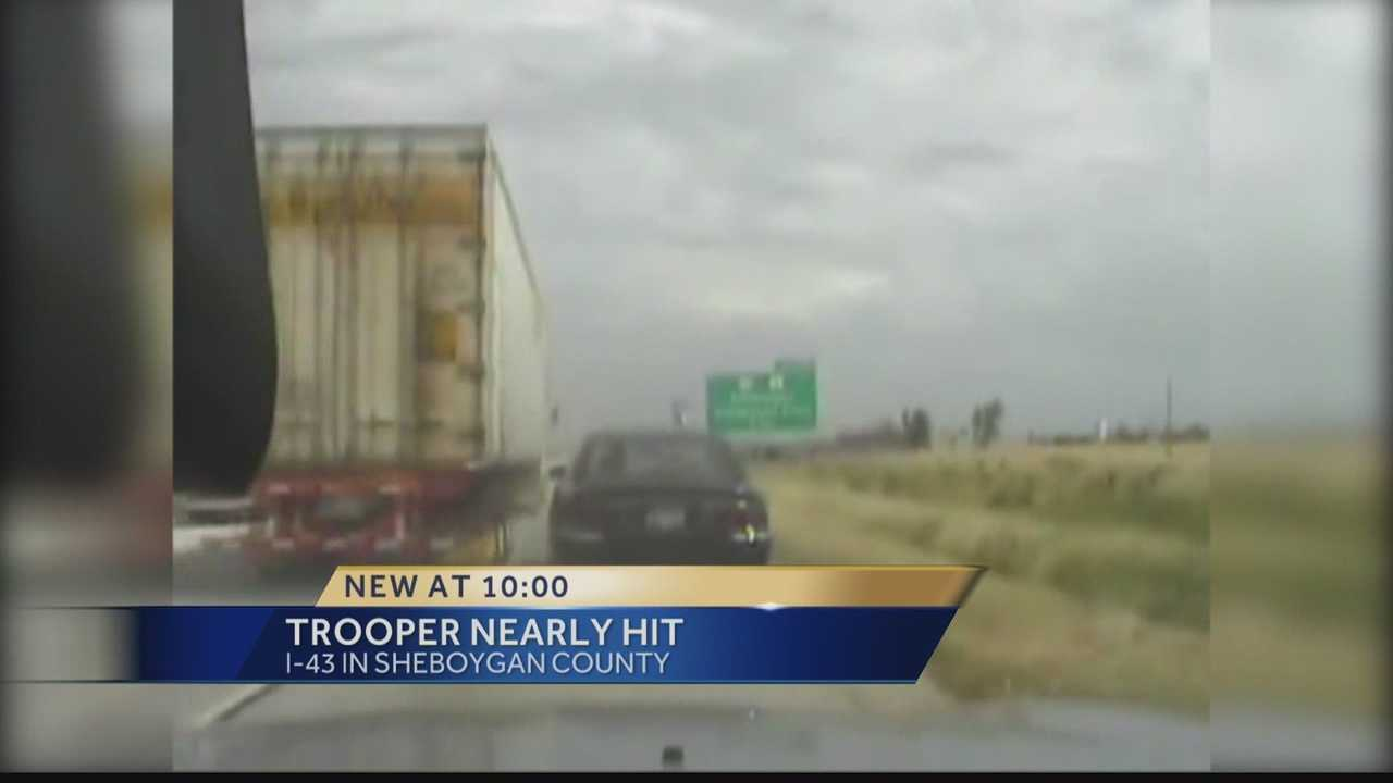 State Trooper in Sheboygan nearly hit by semi.