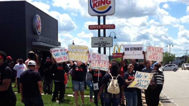 Fast food workers protest on Aug. 1, 2013 outside a Burger King at 76th and Holmes.