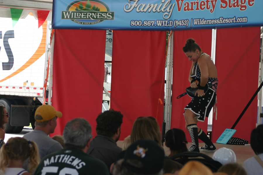 In this show at the Family Variety Stage, Mama Lou- American Strong Woman, performs feats of strength.