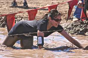 The Warrior Dash has competitors burying through tunnels and racing through mud to finish their 5K obstacle course