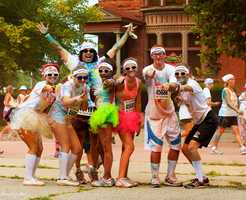 The Color Run is color madness as runners make there way through a 5K while being pelted with chalk.