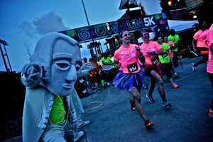 The Glow Run is an electrifying 5K through the streets of Madison. As the evening goes on, runner's light up the track underneath the black lights of the race.