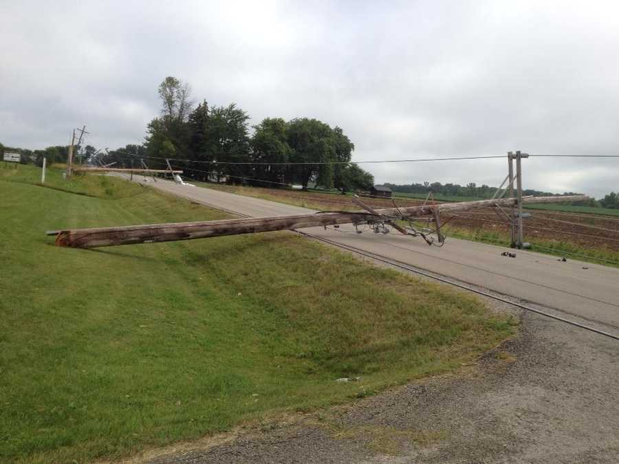 Nearly a half-mile of power poles lay on French Road north of Appleton.