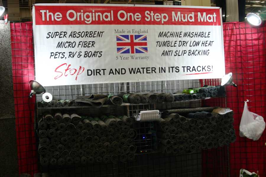 "The Original One Step Mud Mat ""stops dirt and water in its tracks""."