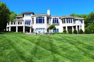 This house was designed to take advantage of the view of Pewaukee Lake and the surrounding hills. It has five bedrooms and six baths spread over 7,500 square feet of living space. For more information on this property, click here.