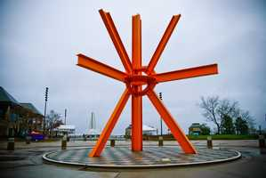 The Calling is a public artwork by American artist Mark di Suvero located in O'Donnell Park. Constructed in 1981-82 from steel I-beams painted an orange-red color, it measures 40 feet in height and sits at the end of Wisconsin Avenue. Milwaukee residents remain soundly divided on both its aesthetic merit and it's physical location - somewhat obfuscating the view of the Quadracci Pavillion from Wisconsin Avenue.