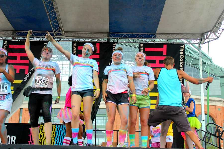 Rachel Bartelson, Jorin Fredman, and Taryn Sherman get a chance to dance on stage with other contestants at the finish line rally