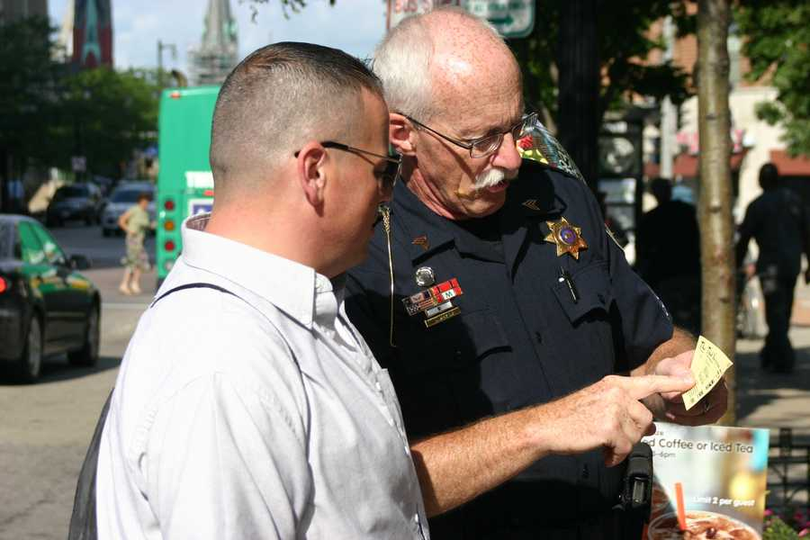At the downtown location Wisconsin State Fair Police officers explained the fund raiser to people walking by.