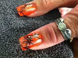 Kathy at Tips and Toes in Oconomowoc is doing Harley nails.