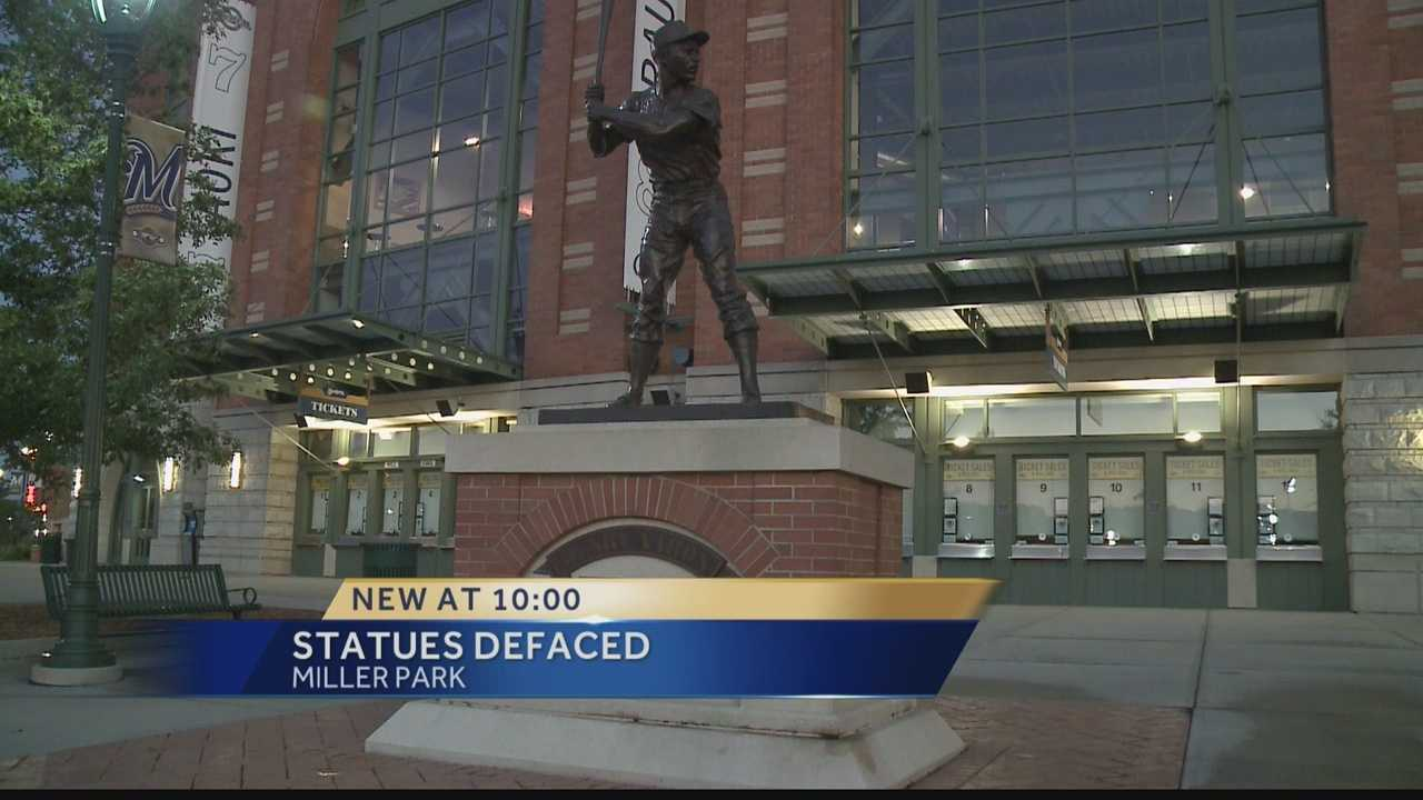 A woman is under arrest after police said she threw blue paint on several statues at Miller Park.