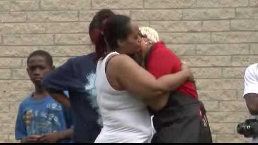 people hug after toddler death