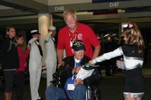 A number of gifts are presented to the vets when they return including a book.