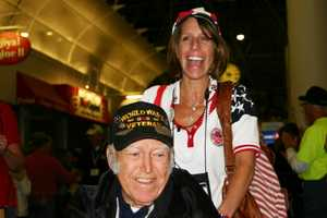 Amy Luft, SSHF board member, escorting a vet throught the parade route.