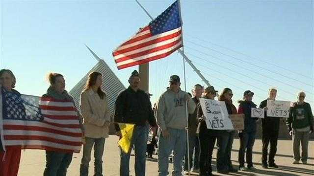 A group gathered at the War Memorial in Milwaukee on Sunday to protest the government shutdown and the closure of national memorials.