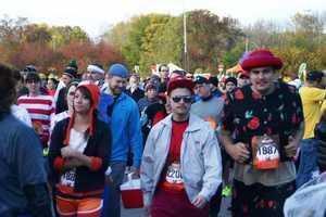 Quarter marathon= approximately 6.6 miles.