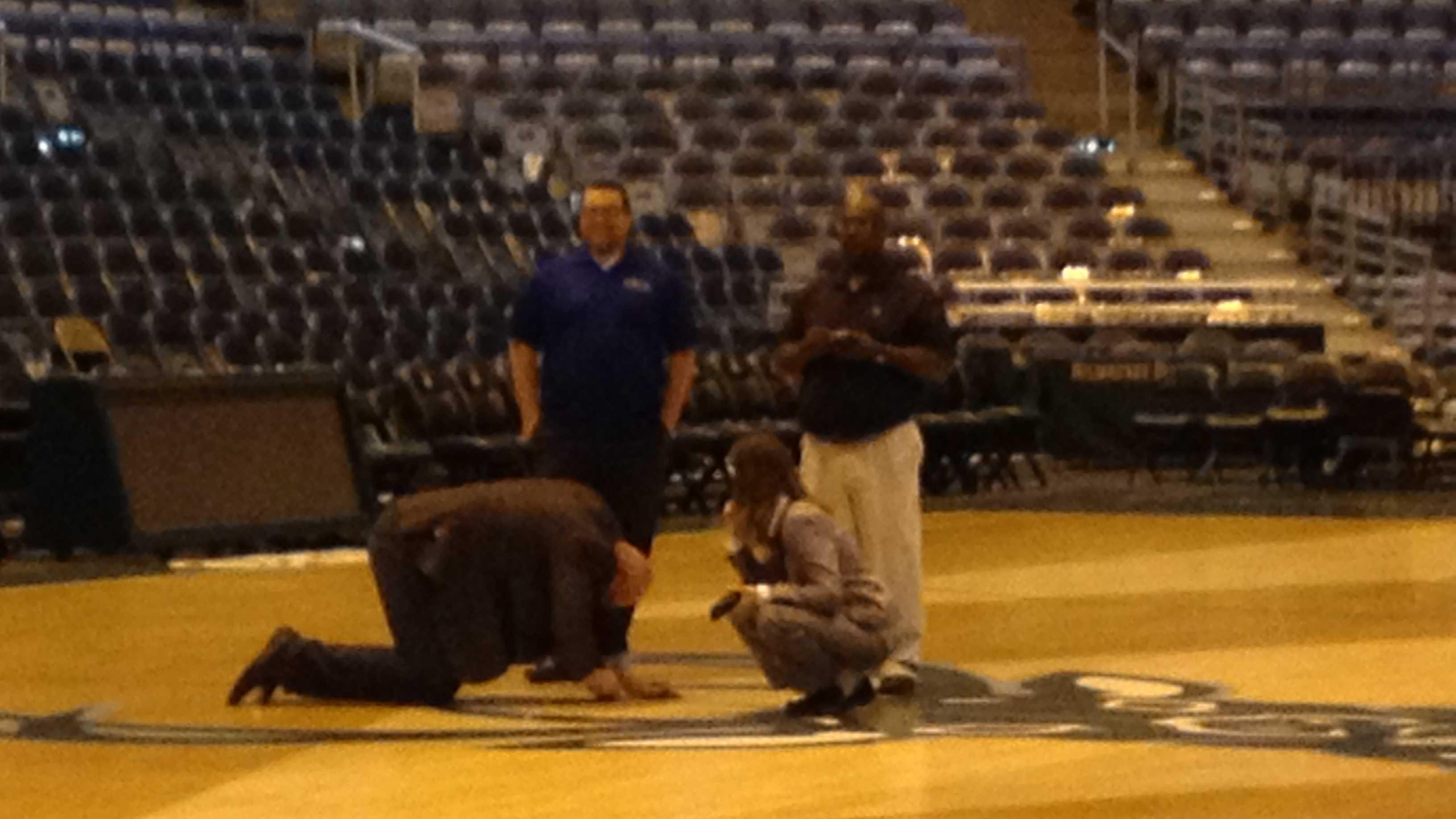 officials inspect floor