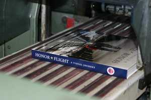 The printing was underwritten by WE Energies so the purchase price will be split equally between Star and Stripes Honor Flight and Fisher House Wisconsin.