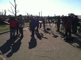 Media from across the country gather for a briefing from state officials.