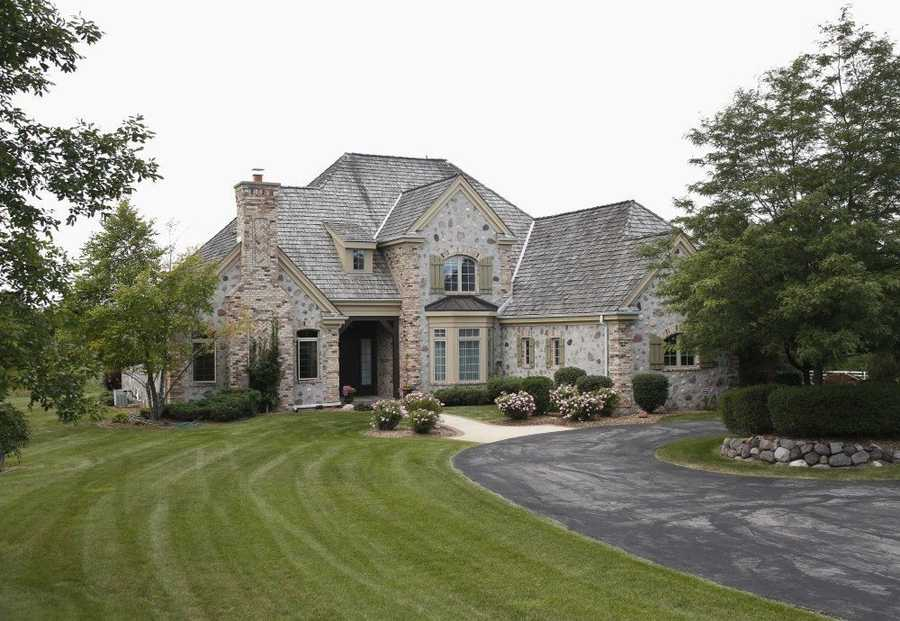 Built in 2002, this house with four bedrooms and six baths, is listed at $959,000. It has a four-car garage and is on a wooded, professionally landscaped lot. For more information on this property, click here.