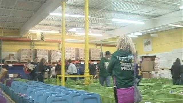 Dozens of volunteers filled bins with holiday food at the Hunger Task Force on Sunday.
