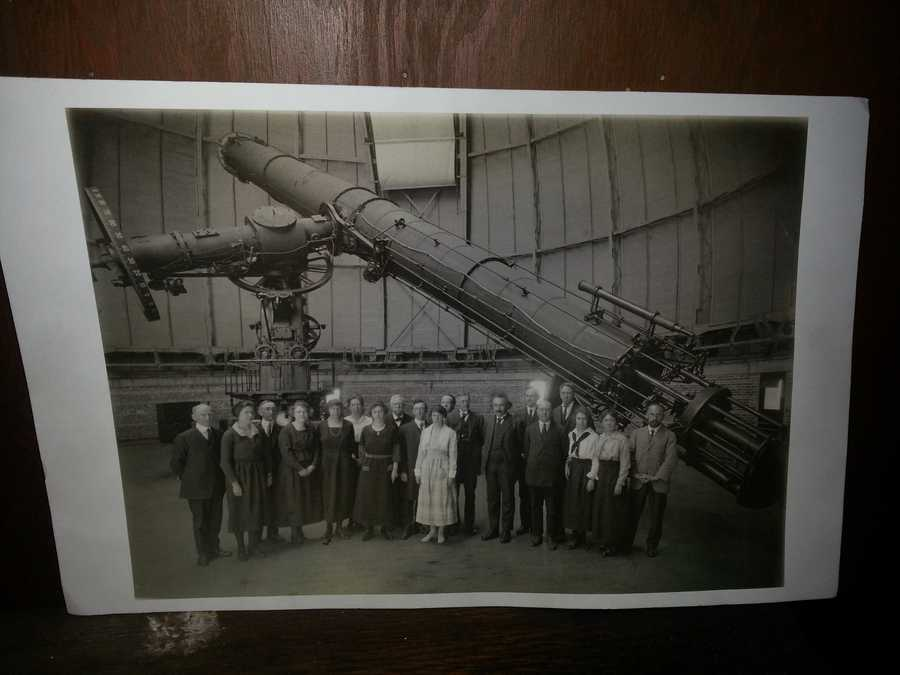 Albert Einstein is pictured in front the telescope.