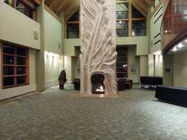 The fireplace was sculpted by local artist Susan Falkman and was completed before the building, they built the building around the sculpture.