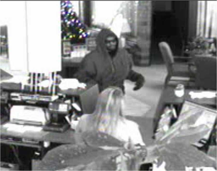 Racine police release surveillance photos of a man who robbed the North Shore Bank on Main Street in Racine on Thursday.