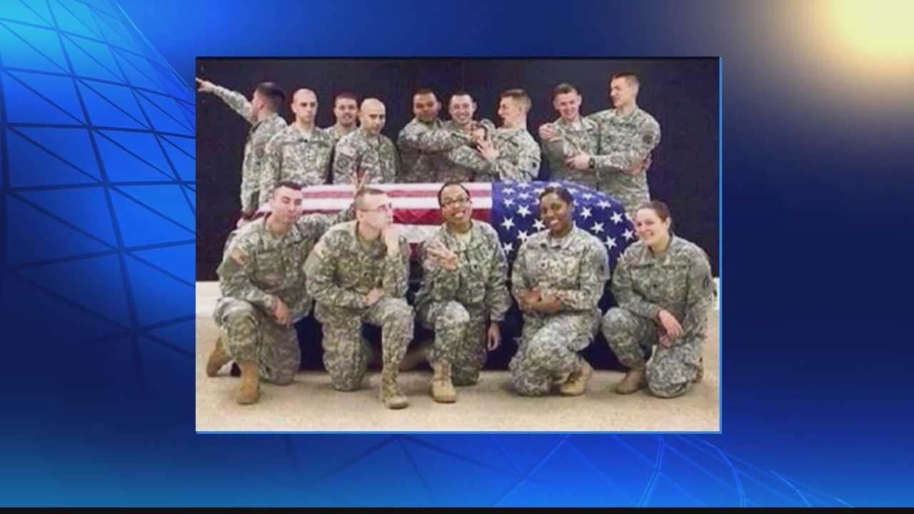 A Wisconsin National Guard soldier is suspended from duty after she posted photos on social media sites.