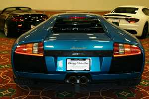 "2004 Lamborghini Murcielago- There are two different displays of rare luxury cars (duPont REGISTRY™ LIVE) and expensive ""toys"" (Harry Kaufmann Motor Cars) at this year's Greater Milwaukee Auto Show."