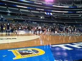 University of Connecticut players practice. UConn will take on No. 1-seeded Florida before the Wisconsin-Kentucky game.