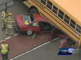 A car is stuck under a school bus at Falls Road  and Wisconsin Avenue in Grafton.