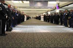 The long line of active duty, retired, ceremonial and distinguished guests when the vets deplane.
