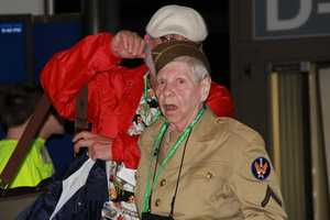 The reaction of many of the vets when they see all of the people assembled and saluting when they exit the plane.