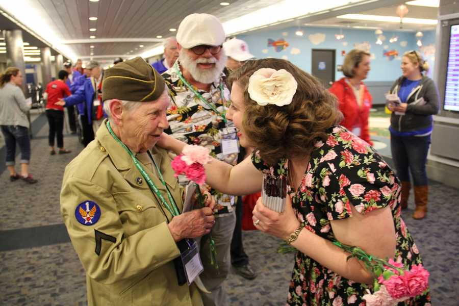 The vets are also greeted by the 1940's girls, dressed in period costumes.