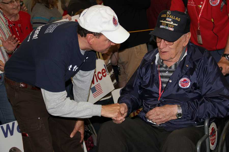 Joe Dean, founder of SSHF, greets vets as they return.