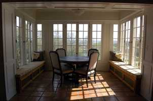 The second floor sunroom sits above the front porch and has a gorgeous view.