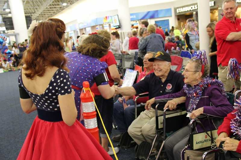 The 40's Bombshells talk to a vet who was on a previous flight.