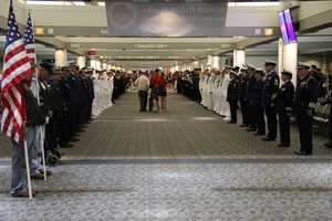 Check out the long line of active duty military members greeting and saluting the vets as they exit the plane.