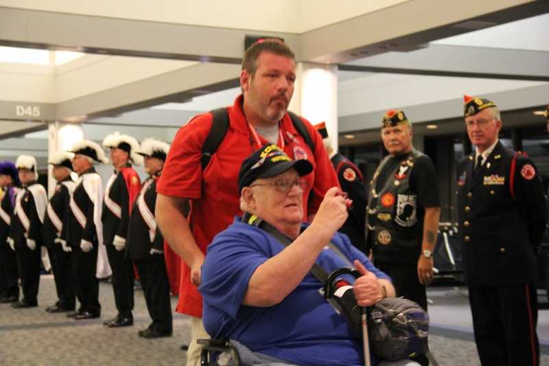 The vets are first greeted by active duty personnel and other dignitaries before making their way to the public homecoming in the main terminal.