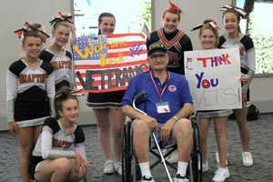 The Grafton cheerleaders take a moment to pose with this vet.