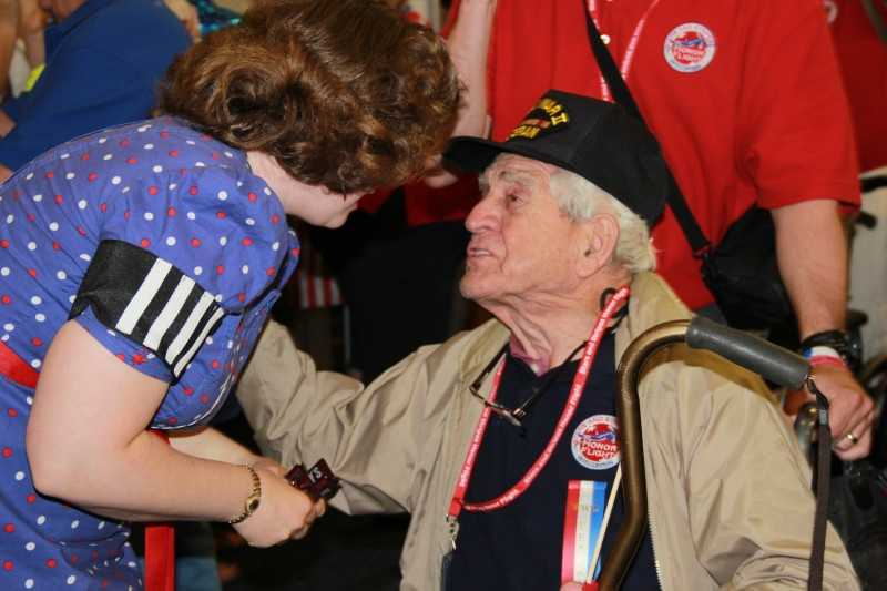 Molly, one of the 40's Bombshells, welcomes home this vet.